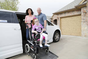 Photo - Brenda and Mike Greene pose with their daughter, Macie, and their new  van.  Photo by Doug Hoke, The Oklahoman <strong>DOUG HOKE - THE OKLAHOMAN</strong>
