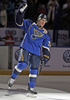 Photo - St. Louis Blues' T.J. Oshie waves to the crowd after being named the star of the game after scoring the game-winning goal in overtime of an NHL hockey game against the Boston Bruins Thursday, Feb. 6, 2014, in St. Louis. The Blues won 3-2. (AP Photo/Jeff Roberson)