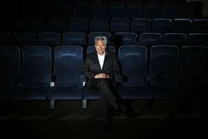 Photo - In this Wednesday, Feb. 6, 2013, photo, Kevin Tsujihara, poses for photos in a screening room at the Warner Bros. Studios in Burbank, Calif.  On Friday, Feb. 28, 2013, Tsujihara, 48, who grew up making deliveries as the son of egg distributors, will become the CEO of Warner Bros. Entertainment. The third-generation Japanese-American will be the first Asian-American to head a Hollywood studio.(AP Photo/Jae C. Hong)