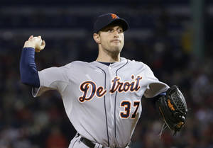 Photo - Detroit Tigers' Max Scherzer throws in the first inning during Game 2 of the American League baseball championship series against the Boston Red Sox Sunday, Oct. 13, 2013, in Boston. (AP Photo/Matt Slocum)