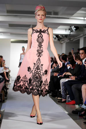 Photo -   This image released by Starpix shows Daria Strokous modeling an outfit for the presentation of the Oscar de la Renta Spring 2013 collection sponsored by Revlon at Fashion Week in New York, Tuesday, Sept. 11, 2012. (AP Photo/Starpix, Amanda Schwab)