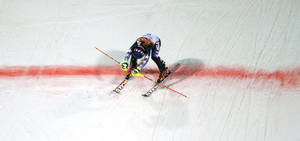 Photo - Gold medal winner Mikaela Shiffrin crosses the finish line in the women's slalom at the Sochi 2014 Winter Olympics, Friday, Feb. 21, 2014, in Krasnaya Polyana, Russia.   (AP Photo/Charlie Riedel)