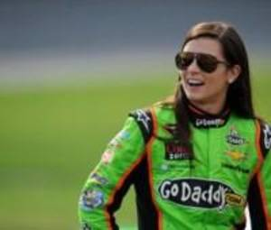 Photo - CONCORD, NC - MAY 17:  Danica Patrick, driver of the #10 GoDaddy Chevrolet, stands on the grid during qualifying for the NASCAR Sprint Cup Series Showdown at Charlotte Motor Speedway on May 17, 2013 in Concord, North Carolina.  (Photo by Jared C. Tilton/Getty Images)