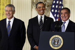 photo - In this Jan. 7, 2013, file photo, President Barack Obama and his choice for Defense Secretary, former Nebraska Sen. Chuck Hagel, left, laugh as current Defense Secretary Leon Panetta speaks in the East Room of the White House in Washington, Monday, Jan. 7, 2013, where the president announced his nomination of Hagel. In 1989, former President Richard Nixon said unless a nominee is clearly unqualified, the Senate should respect the right of a president to fill his Cabinet. Nixon's words came during the bitter fight over President George H.W. Bush's choice of John Tower for the Pentagon post. The Democratic-led Senate rejected him. Now, Obama's choice of Hagel to be defense secretary will be a test for Senate Republicans, including those who fought strenuously for Tower. (AP Photo/Charles Dharapak, file)