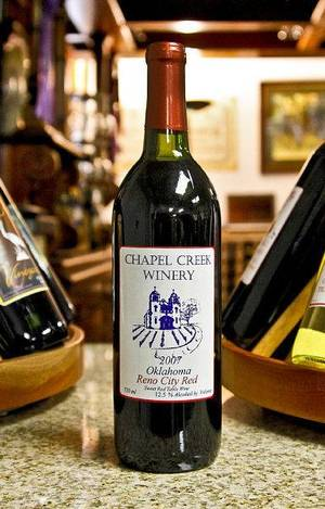 Photo - A bottle of red wine created at Chapel Creek Winery in El Reno. Photo by Chris Landsberger, The Oklahoman <strong>CHRIS LANDSBERGER</strong>