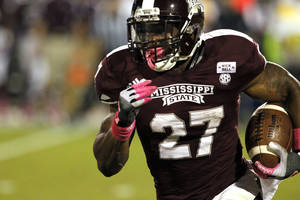 Photo -   Mississippi State running back LaDarius Perkins (27) runs for short yardage in the second quarter of an NCAA college football game against Tennessee in Starkville, Miss., Saturday, Oct. 13, 2012. (AP Photo/Rogelio V. Solis)
