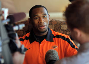 Photo - COLLEGE FOOTBALL: Joseph Randle speaks to the media during the OSU spring football press conference at Boone Pickens Stadium on the campus of Oklahoma State University in Stillwater, Okla., Monday, March 12, 2012. Photo by Nate Billings, The Oklahoman