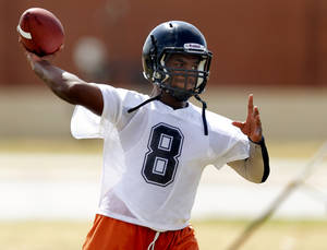 Photo - Douglass' Timothy Harle throws a pass during practice on Aug. 7.  Photo by Bryan Terry, The Oklahoman