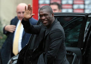 Photo - Clarence Seedorf waves to journalists upon his arrival at the AC Milan soccer team headquarters in Carnago, Italy, Thursday, Jan. 16, 2014. Seedorf signed a 2½-year contract with AC Milan on Thursday and immediately went to the training ground to meet the players. Seedorf landed in Milan on Wednesday to replace Massimiliano Allegri, who was fired following a 4-3 loss at newly promoted Sassuolo on Sunday. Seedorf was contracted to June 30, 2016, Milan said in a statement. The 37-year-old Seedorf spent 10 years as a player with Milan, helping the team win a number of trophies, including two Champions League titles and two Serie A titles. (AP Photo/Andreoli Emilio, LaPresse)