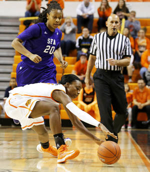 photo - Oklahoma State's Toni Young, bottom, tries to gain control of the ball in front of Stephen F. Austin's Antionette Carter during Thursday's game at Gallagher-Iba Arena in Stillwater. Photo by Bryan Terry, The Oklahoman