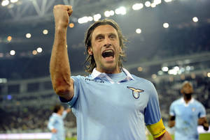 photo - Lazio's Stefano Mauri celebrates after scoring during the Italian Cup semifinal soccer match between Juventus and Lazio at the Juventus stadium in Turin, Italy, Tuesday, Jan. 22, 2013. (AP Photo/Marco Rosi, Lapresse)