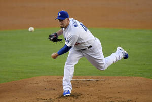 Photo - Los Angeles Dodgers relief pitcher Paul Maholm throws to the plate during the second inning of a baseball game against the San Diego Padres, Saturday, July 12, 2014, in Los Angeles. (AP Photo/Mark J. Terrill)