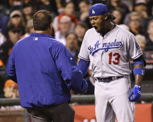 Photo - Los Angeles Dodgers' Hanley Ramirez reacts after being hit by a throw from San Francisco Giants' Ryan Vogelsong during the seventh inning of a baseball game on Wednesday, April 16, 2014, in San Francisco. (AP Photo/Marcio Jose Sanchez)