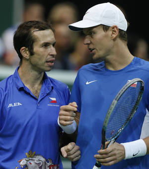 Photo -   Czech Republic's Tomas Berdych, right, talks to his teammate Radek Stepanek, left, during their tennis Davis Cup final doubles match against Spain's Marcel Granollers and Marc Lopez in Prague, Czech Republic, Saturday, Nov. 17, 2012. (AP Photo/Petr David Josek)