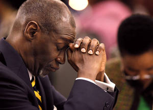 "photo - Dr. George E. Young, Sr. in a posture of silent prayer while invocation is delivered by Rev. Puong Ong Lau from Edmond Chinese International United Methodist Church during the 16th annual Midwest City Dr. Martin Luther King, Jr. Prayer Breakfast inside the Reed Conference Center Monday morning, Jan. 21, 2013. The theme of this year's event is ""The Wisdom of Peace.""  Young is senior pastor at Holy Temple Baptist Church in Oklahoma City. About 400 people attended.  Later in the program, Young was honored as recipient of the Clara Luper Community Award.  Photo by Jim Beckel, The Oklahoman"