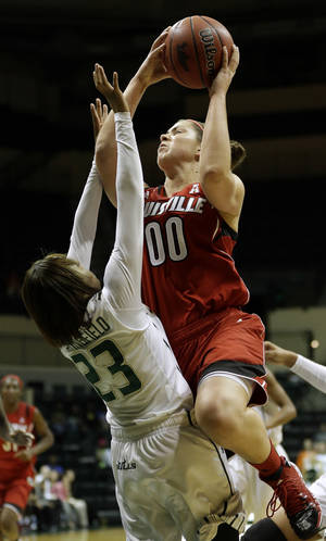 Photo - Louisville forward Sara Hammond (00) goes over South Florida guard Shalethia Stringfield (23) during the first half of an NCAA college basketball game on Sunday, Jan. 12, 2014, in Tampa, Fla. (AP Photo/Chris O'Meara)