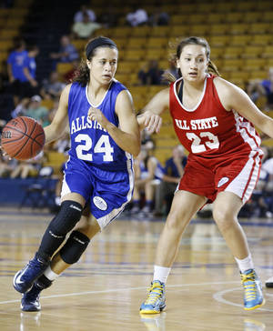 Photo - Bartlesville's No.24 Paige Wilson on the east team tries to get around Anadarko's No.23 Lakota Beatty on the west during the large All State Basketball game at the ORU Mabee Center in Tulsa, Okla., taken on July 31,2013. JAMES GIBBARD/Tulsa World