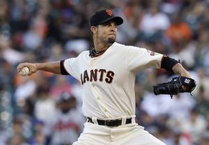 Photo - San Francisco Giants pitcher Ryan Vogelsong throws against the Atlanta Braves during the first inning of a baseball game in San Francisco, Tuesday, May 13, 2014. (AP Photo)