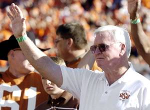 Photo - Former Oklahoma State head coach Jim Stanley waves to the crowd after a halftime ceremony during a 2008 game in Stillwater. Stanley is battling lung cancer in an Arizona hospital. OKLAHOMAN ARCHIVE PHOTO <strong>Matt Strasen</strong>