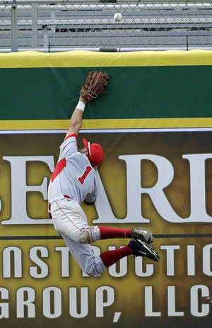 Photo - Houston outfielder Landon Appling (1) leaps for a double off the wall by Southeastern Louisiana's Gabe Woods in the ninth inning of an NCAA college baseball regional tournament game in Baton Rouge, La., Sunday, June 1, 2014. Houston won 9-5. (AP Photo/Gerald Herbert)
