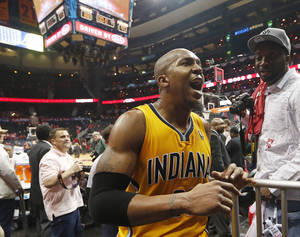 Photo - Indiana Pacers forward David West reacts as he leaves the court after Game 6 of a first-round NBA basketball playoff series against the Atlanta Hawks in Atlanta, Thursday, May 1, 2014. Indiana won 95-88. (AP Photo/John Bazemore)