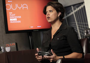 Photo - Julie Uhrman, chief executive of Android game console maker Ouya, is interviewed in New York, Tuesday, June 25, 2013.  Ouya, that went on sale Tuesday for $99, aims to challenge the dominance of the Xboxes, Nintendos and PlayStations of the world. The launch follows a successful funding campaign through the group-fundraising site Kickstarter, but it's unclear whether the console will enjoy broader success. (AP Photo/Richard Drew)