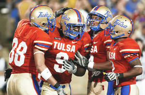 Photo - Tulsa players (from left) Slick Shelley, Charles Clay, Brennan Marion and Damaris Johnson celebrate a touchdown during a 2008 win over Rice. Shelley had eight touchdowns last season, while Clay had 11.AP Photo