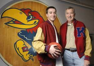 Photo - University of Kansas college basketball guard  Brady  Morningstar and his father Roger  Morningstar. PHOTO PROVIDED BY STEVE PUPPE PHOTOGRAPHY
