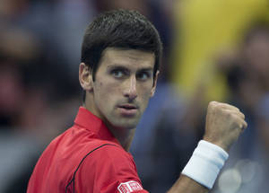 Photo - Novak Djokovic of Serbia rects after defeating Fernando Verdasco of Spain during the China Open tennis tournament at the National Tennis Stadium in Beijing, China Thursday, Oct. 3, 2013. (AP Photo/Andy Wong)