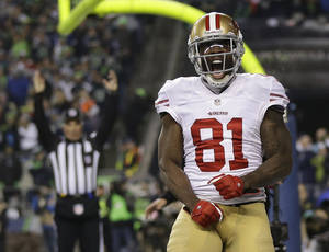 "Photo - FILE - In this Jan. 19, 2014 file photo, San Francisco 49ers' Anquan Boldin celebrates his touchdown catch during the second half of the NFL football NFC Championship game against the Seattle Seahawks, in Seattle. Boldin says he will be back with the San Francisco 49ers next season. Boldin wrote on his Twitter page Monday, March 3, 2014,  that he's ""returning to San Francisco. A spokesman for the 49ers said the team had no immediate comment. (AP Photo/Marcio Jose Sanchez, File)"