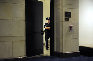 Photo -   A Capitol Hill Police officer guards a staircase near the hearing room where former CIA Director David Petraeus is testifing before the House Intelligence committee on the Sept. 11, 2012 attack in Libya, on Capitol Hill in Washington, Friday, Nov. 16, 2012. (AP Photo/Cliff Owen)