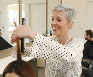 Photo - Sarah Payne, a stylist at The Barber Salon in Oklahoma City, is among the Oklahomans who have selected a plan through the federal health insurance marketplace.  Photo by Paul Hellstern, The Oklahoman <strong>PAUL HELLSTERN -   </strong>