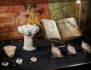 """Photo - These items are on display in """"Passages,"""" a traveling exhibition of rare biblical texts and assorted artifacts featured at the Oklahoma City Museum of Art. Photo by Jim Beckel, The Oklahoman  <strong>JIM BECKEL</strong>"""