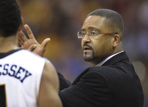 Photo - Missouri coach Frank Haith talks with guard Phil Pressey (1) during the first half of an NCAA college basketball game against Baylor in the Big 12 Championship tournament in Kansas City, Mo., Saturday, March 10, 2012. (AP Photo/Reed Hoffmann)