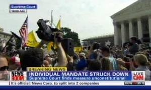 Photo -   This television frame grab shows CNN broadcasting the Supreme Court's decision incorrectly on President Barack Obama's health care law on Thursday, June 28, 2012. Both CNN and Fox News Channel incorrectly reported Thursday that the law's central provision, requiring virtually all Americans to have health insurance, had been struck down. Both networks backtracked when it became clear that the court upheld the provision. Broadcast networks broke into regular programming to deliver special reports and generally got it right. To get the news out quickly, competitive news organizations had to wade through pages of legal writing. (AP Photo)