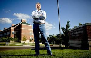 photo - OKLAHOMA STATE BUREAU OF INVESTIGATION: Kyle Eastridge stands in front of the OSBI building in Edmond, Okla., Thursday, July 22, 2010.  Photo by Bryan Terry, The Oklahoman ORG XMIT: KOD