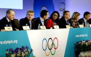 Photo - International Olympic Committee President Thomas Bach, second from left, opens the IOC's general assembly at the 2014 Winter Olympics, Wednesday, Feb. 5, 2014, in Sochi, Russia. (AP Photo/David Goldman)