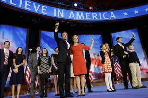 Photo -   Standing with their families, Republican presidential candidate and former Massachusetts Gov. Mitt Romney stands with his wife Ann, and Republican vice presidential candidate Rep. Paul Ryan, R-Wis., second right, stands with his wife Janna after Romney's concession speech at his election night rally in Boston, Wednesday, Nov. 7, 2012. (AP Photo/Charles Dharapak)