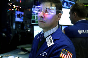 "Photo - FILE - In this Monday, Dec. 31, 2012, file photo, a trader wearing ""2013"" glasses works on the floor at the New York Stock Exchange in New York. While 2013 was a great year for the average investor, few market strategists believe that 2014 will be anywhere near as good. (AP Photo/Seth Wenig, File)"