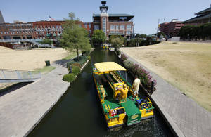 Photo - Oklahoma City is applying for a federal grant to convert the Bricktown water taxi fleet to electric power. The taxis, like the one shown here Wednesday, are powered by gasoline. <strong>Steve Gooch</strong>