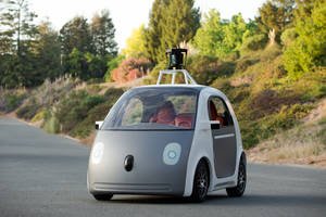 Photo - This image provided by Google shows a very early version of Google's prototype self-driving car. The two-seater won't be sold publicly, but Google on Tuesday, May 27, 2014 said it hopes by this time next year, 100 prototypes will be on public roads. (AP Photo/Google)