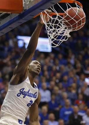 Photo - Kansas center Joel Embiid dunks during the first half of an NCAA college basketball game against Oklahoma in Lawrence, Kan., Monday, Feb. 24, 2014. (AP Photo/Orlin Wagner)