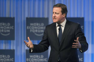 photo - British Prime Minister, David Cameron, gestures as he speaks to the assembly of the 43rd Annual Meeting of the World Economic Forum, WEF, in Davos, Switzerland, Thursday, Jan. 24, 2013. (AP Photo/Michel Euler)
