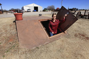 Photo - Nita Biggs of Biggs Storm Shelters in Piedmont shows a 6-by-8-foot model on display.   Photo by Paul B. Southerland, The Oklahoman <strong>PAUL B. SOUTHERLAND -   </strong>