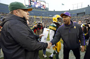 Photo - Green Bay Packers head coach Mike McCarthy is congratulated by Minnesota Vikings head coach Leslie Frazier after an NFL football game Sunday, Dec. 2, 2012, in Green Bay, Wis. The Packers won 23-14. (AP Photo/Tom Lynn)