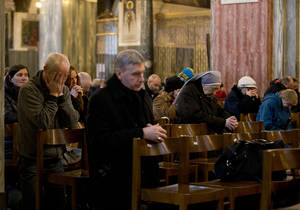 photo - People pray during a Mass at Westminster Cathedral, in London, which is the Mother Church for Roman Catholics in England and Wales, Monday, Feb. 11, 2013.  Pope Benedict XVI said Monday he lacks the strength to fulfill his duties and on Feb. 28 will become the first pontiff in 600 years to resign. The announcement sets the stage for a conclave in March to elect a new leader for the world's 1 billion Catholics.  (AP Photo/Matt Dunham)