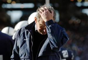 Photo - In this Nov. 6, 2004, file photo, Penn State coach Joe Paterno pauses on the sidelines during the fourth quarter of his team's 14-7 loss to Northwestern in State College, Pa. The NCAA has slammed Penn State with an unprecedented series of penalties, including a $60 million fine and the loss of all coach Joe Paterno's victories from 1998-2011, in the wake of the Jerry Sandusky child sex abuse scandal. (AP Photo/Carolyn Kaster,file)