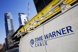 Photo - CORRECTS YEAR OF REPORT TO 2014 - FILE - In this Feb. 2, 2009 file photo, a Time Warner Cable truck is parked in New York.Time Warner Inc. reports quarterly earnings on Wednesday, Feb. 5, 2014. (AP Photo/Mark Lennihan, file)