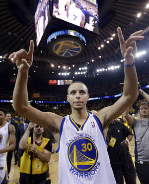 Photo - Golden State Warriors' Stephen Curry celebrates after a 92-88 win over the Denver Nuggets during Game 6 in a first-round NBA basketball playoff series in Oakland, Calif., Thursday, May 2, 2013. (AP Photo/Marcio Jose Sanchez)
