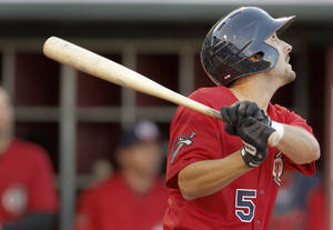 photo - The RedHawks' Collin DeLome singles on Wednesday. Photo by Bryan Terry, The Oklahoman